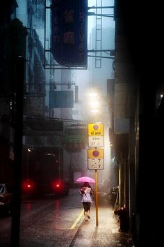 This is really cool, the kind of image I'd like to capture, like the fact it's night time, like the use of colours and composition with the subject to the light, and again it's raining.