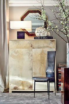 A goatskin parchment armoire in Interior Designer's Ryan Korban New York home Photography by Matt Ramirez