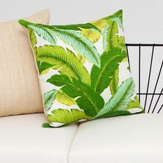 Raffia Cushion....ooo yes, for a screened porch during the spring & summer. <3 it