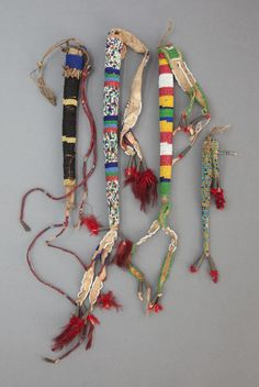 American Indian Art:Beadwork and Quillwork, FOUR SIOUX BEADED HIDE AWL CASESc. 1890 and 19... Image #1