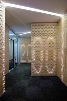 Illuminated wall number sign at Locomobile Lofts by Studio IDE