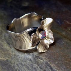 This was a custom ring done for a friend of mine a couple of years ago, that I have now decided to put in the shop.  I might even make one for me to celebrate Spring!
