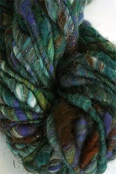Cast Away comes in a range of hand-carded neutrals with bits of brights colors handspun throughout. In some colorways 10 fibers colors are all carded and spun together. The finished result is a beauti