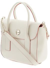 This classically styled white Kate Spade handbag is the perfect accessory for any fun summer outfit!