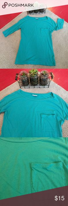 🚨  Teal pocket t-shirt Color: teal  Description: comfy lightweight everyday tee with a pop of color! 3/4 length sleeves and a front left breast pocket. Pre-loved condition, only worn a few times, some minor pre-pilling seen in photos. Offers encouraged!   ❤️ Always open to offers/ questions! Discount for bundles of 2+ items! ALLOY Tops Tees - Long Sleeve