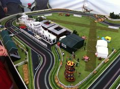 Saw this Scalextric Goodwood circuit at the Revival Meeting. It was there to promote insurance, but was quite clever. Much scaled down to get it on the stand, but some clever scenery… made by the Racing Room in Nottingham.