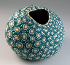 Melanie Wests vessel shows a bright, busy, almost graphic pattern on a very strong, natural and bulbous form.