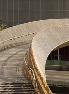 """A+Awards: another of this year's winners at the Architizer A+Awards is a wood-sided bridge that connects Paris with the suburb of Aubervilliers. Designed by French architecture studio DVVD, the bridge gently curves over the busy dual carriageways at a point north of the city centre. """"We designed it as a thin recognisable line overflying the"""