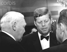 John F. Kennedy visits the Federal Republic of Germany in 1963 US President John F. Kennedy (m) talks to his guests at a reception organized in his honor at Palais Schaumburg in Bonn on 23 June 1963. Here, he is talking to Federal Economy Minister Ludwig Erhard (l, backview). President Kennedy was visiting the federal republic for four days.  Date Photographed:June 23, 1963.☀❤☀❤☀❤☀❤☀  http://en.wikipedia.org/wiki/John_F._Kennedy