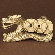 mammoth-ivory-powerful-dragon-netsuke-carving