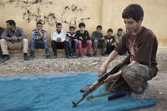 March 13, 2013 - ARTICLE - CHILD SOLDIERS - WAR CRIMES: REGIME & REBELS - CHILDREN - GUN - Children are being increasingly recruited on the frontline in Syria's war, with both sides to the conflict using boys as soldiers and even human shields, a British charity said on Wednesday.