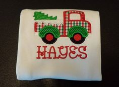 Christmas Truck is appliqued directly onto a super soft white bib, bodysuit or t-shirt with your child's name embroidered directly below the applique in your choice of font style. Choose from boy's crew neck t-shirt or girl's lettuce edge t-shirt. Choose your favorite font style here .  Leave information in boxes below.