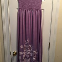 Cute Maxi  lavender  knit dress with bandeau top. Lavender strapless jersey knit dress with stretchy top.It also ha a floral design on the front only. Extremely cute and nice. I purchased from another but it does not fit me.Size large but fits more like a S/M it may be a large in juniors. My loss , your gain. Chelsky Dresses
