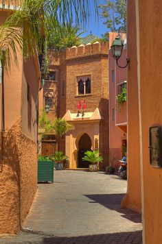 In Morocco, the distant doorway photographically captures, leads me to believe there's a cool patio beyond...perhaps a tagine awaits...  I've an active imagination, but such an excellent photo gives me jettison, even if a magic carpet's my best vehicle!