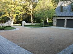 Gravel driveway done right. Edge with pavers to dress itup, contain the gravel, but keep costs down. so much less expensive than all pavers!