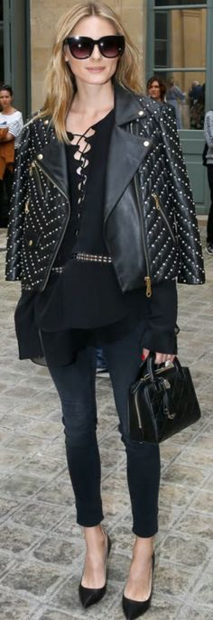 Palermo in  black studded jacket, skinny jeans, and handbag