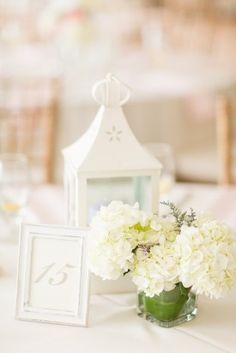 white shabby chic lantern centerpiece with white hydrangea floral: Maryland Springfield Manor wedding by Katelyn James Photography