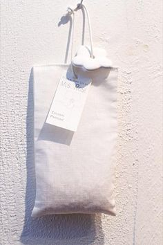 A linen sachet filled Musc Rose  scented beads