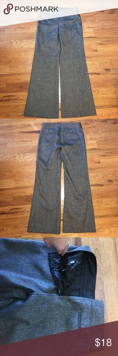 Antonio Melani Gray Dress Slacks Women's Size 8 Antonio Melani Gray Dress Slacks Women's Size 8. Measures 31 inches long in the inseam. Only wore a few times. In great condition, smoke free home and environment, no holes, stains or missing pieces. The zip up in the back, zipper is very sturdy and stays zipped throughout the day. BEAUTIFUL material, look in photos for details. Thanks for looking :) ANTONIO MELANI Pants Trousers