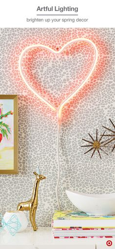 Rethink your gallery wall this spring with Oh Joy! for Target's LED neon heart light. It's an easy way to add a fresh accent to your current mix, or make it a focal point on the wall. Hang it over a buffet or side table and let it shine among favorite books, figurines or small sculptures—the combo will create a cool, modern vibe.