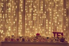 Christmas lights behind sheer curtains to give the room a romantic feel