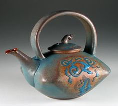 Pillow shaped teapot with copper barium glaze by Steve Irvine