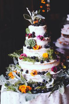 Hummingbird Naked Cake iced with Buttercream Frosting and garnished with fresh fruits, flowers and greens makes for a beautiful rustic wedding cake.