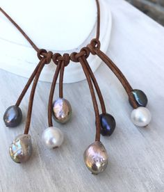 Leather and pearl necklace. Nice!