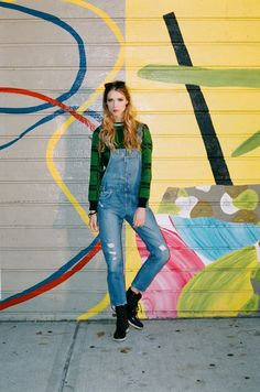 Spotted: Distressed Levi's denim overalls with a Chikimiki plaid sweater. via  New York Magazine.