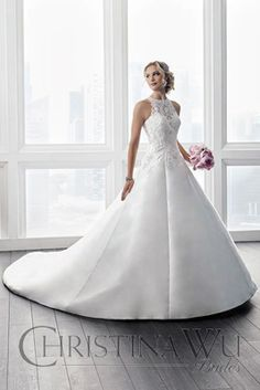 Friday, March 10, 2017 This Christina Wu gown, style 15630, is an A-line mikado gown that is complimented with exquisite lace that begins at the neckline and falls past the natural waist line. The lace has delicate beading throughout and the front neckline and entire back is a sheer illusion. Covered buttons close up the …