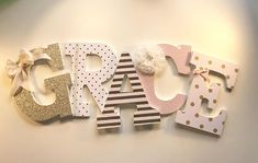 Pink and gold girls nursery letters, Blush and gold nursery letters ::: ZOVINAR ::: {{ PRICE IS $23.00 PER LETTER}} These gorgeous girls nursery letters are done in a pink blush, soft whites and a beautiful gold that looks simply stunning when the light hits it! The