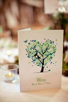 Pretty natureinspired wedding stationery in green and cream with trees and birds. Image by http://lolarosephotography.zenfolio.com/
