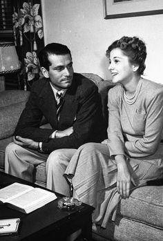 Laurence Olivier and Joan Fontaine at Alfred Hitchcock's apartment while discussing their upcoming roles in his film Rebecca. Photographed by Peter Stackpole, 1939