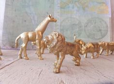 A fun addition to a Birthday Party or Craft Projects. Set of 10 Gold Painted mini Safari Jungle Animals Animals measure from a 1.25 Gorilla to a 2.5 Giraffe. We also have have Gold Horses available in our 525supply shop as pictured above.  SAVE $$$$$ ON SHIPPING by ordering other items from