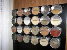 Magnetized spice rack. Fabulous.  Clear lids on labeled tins make finding what you need a snap.