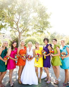 I'm throwing around the idea of having multicolored bridesmaid dresses that mimic the color of beach houses
