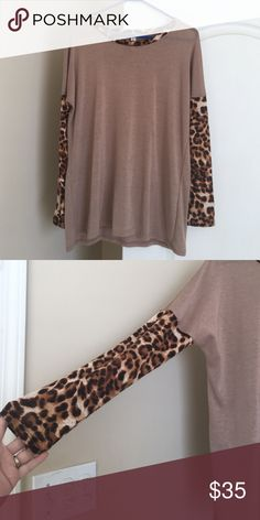 Shirt Tan long sleeve tunic with leopard print sleeves and strip around neck. Perfect length to wear with leggings/tights. Worn twice Tops Tunics