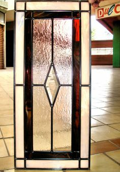 leaded glass kitchen cabinet door-swap the red for gold or amber color similar to colors in fixture in breakfast room
