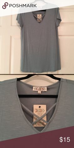 T-Shirt/Tunic Top NWT. Fabric is 95% rayon, 5% spandex in a super pretty powder blue. Perfect for spring! Pink Rose Tops