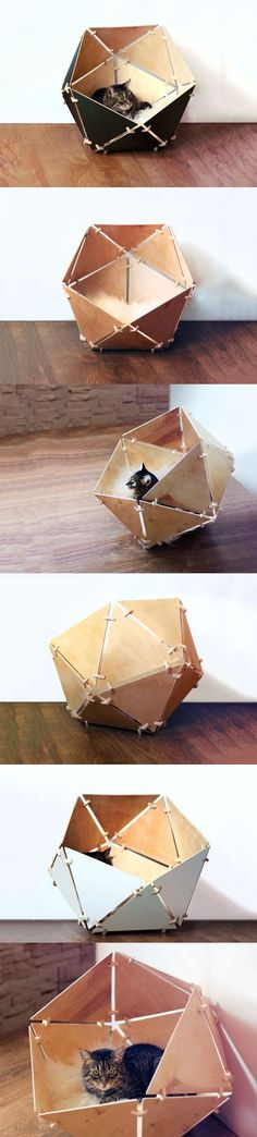 The Geobed is an icosahedral kitty temple. Made out of triangular wooden pieces and fixtures, this easy to assemble cat-bed is the perfect space for your feline! It's cozy and covered; and is really easy to put together!
