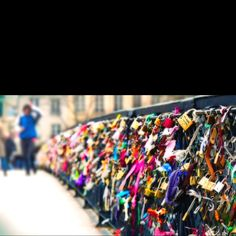The Lovers Bridge in Paris: couples attach a padlock to the bridge and throw the key over the edge to symbolize their never ending love. Adorable