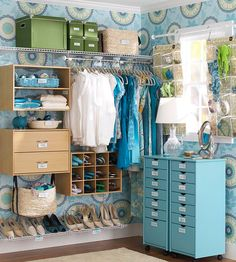 Love the color of this master bedroom closet and the organization tools they used