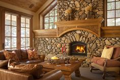 Seriously loving these river rock fireplaces.  Slopeside Apres Vous Tour 1 | Luxury Vacation Rentals, Property Management | Jackson Hole, Wyoming