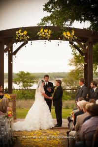 Yellow petals lining the aisle, Yellow and Green flowers decorating the alter | Villa on Lake Georgetown | Matt Montalvo Photography | @pearleventsaustin | Bouquets of Austin