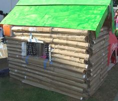 Cardboard Log Cabin. No instructions      :( But I think I can totally build this with rolled up cardboard taped with packing tape and stacked to build a log cabin! Complete with a cardboard roof!