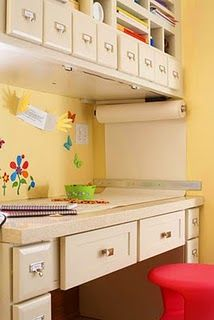 Love the paper roll on the wall...and all the little drawers!