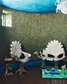 18th century grotto chairs sit amongst a custom-made peacockfeather wall covering in the library.