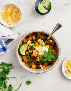 Butternut Squash Black Bean Chili - A hearty spicy vegetarian chili that's perfect for weeknights, game day, or make-ahead lunches. It's SO delicious topped with vegan poblano cashew cream. Vegan, gluten free.