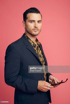 Michael Malarkey from A+E Studios and Compari Entertainment's 'Project Blue Book' poses for a portrait at the Getty Images Portrait Studio powered by Pizza Hut at San Diego 2018 Comic Con at Andaz San Diego on July 2018 in San Diego, California. Micheal Malarkey, Michael Trevino, Enzo Vampire Diaries, The Vampire Diaries Characters, Bonnie And Enzo, Project Blue Book, Blue Books, Famous Men, Studio Portraits
