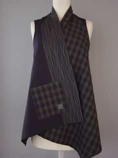 Wrapped Shoulder Vest in Black, Plaid and Stitched Lines Love plaid. This subtle plaid was woven in Japan and has a quiet timelessness. Asymmetrical styling on this easy to wear vest.Pieced and quilted.